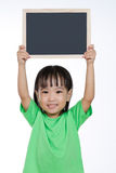Asian Chinese little girl holding chalkboard Stock Photos
