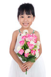 Asian Chinese little girl holding flowers greeting for mother`s Stock Photography
