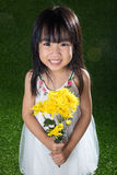 Asian Chinese little girl holding flowers Stock Photos