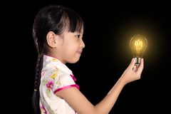 Asian chinese little girl holding a light bulb stock photography