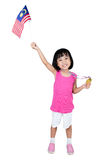 Asian Chinese little girl holding Malaysia Flag with gold medal Royalty Free Stock Photos
