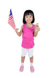 Asian Chinese little girl holding Malaysia Flag with gold medal Stock Photo