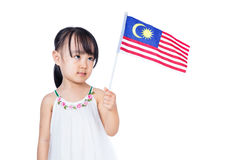 Asian chinese little girl holding Malaysian Flag in isolated whi Royalty Free Stock Image