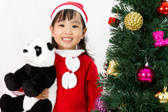 Asian Chinese little girl holding panda doll posing with Christm Royalty Free Stock Image