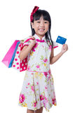 Asian Chinese little girl holding shopping bags with credit card Stock Image