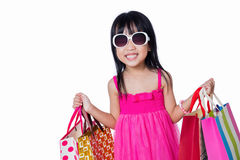 Asian Chinese little girl holding shopping bags Royalty Free Stock Photos