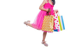 Asian Chinese little girl holding shopping bags Royalty Free Stock Photo