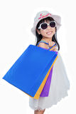 Asian Chinese little girl holding shopping bags Stock Images