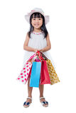 Asian Chinese little girl holding shopping bags Royalty Free Stock Images