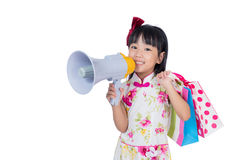 Asian Chinese little girl holding shopping bags and loudspeaker Stock Image