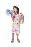 Asian Chinese little girl holding shopping bags and loudspeaker Royalty Free Stock Photo