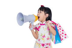 Asian Chinese little girl holding shopping bags and loudspeaker Stock Photography