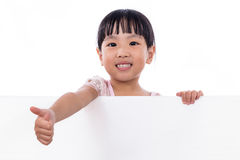 Asian Chinese little girl holding white board with thumbs up Stock Image