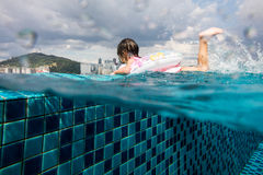 Asian Chinese little girl learning at the outdoor swimming pool Royalty Free Stock Image