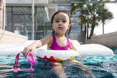 Asian Chinese little girl learning at the outdoor swimming pool Stock Images