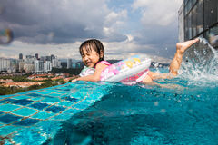 Asian Chinese little girl learning at the outdoor swimming pool Stock Image