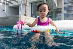 Asian Chinese little girl learning at the outdoor swimming pool Royalty Free Stock Photo