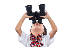 Asian Chinese little girl looking through binoculars. In isolated white background stock image