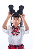 Asian Chinese little girl looking through binoculars. In isolated white background royalty free stock photos