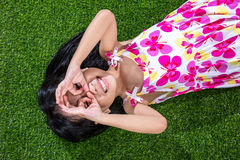 Asian Chinese little girl lying on the grass Stock Photos