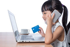 Asian Chinese little girl making online payment Stock Photos