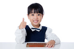 Asian Chinese little girl playing abacus. In isolated white background Stock Photos