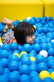 Asian Chinese Little Girl Playing At Balls Pool Royalty Free Stock Image