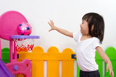 Asian Chinese little girl playing basketball Royalty Free Stock Photo