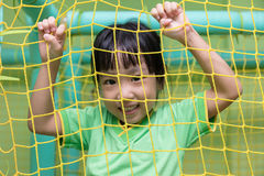 Free Asian Chinese Little Girl Playing Behind The Net Royalty Free Stock Photos - 98146378