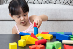 Asian Chinese little girl playing building blocks at home Royalty Free Stock Images