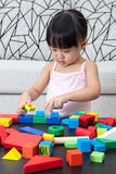 Asian Chinese little girl playing building blocks at home Stock Photo