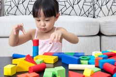 Asian Chinese little girl playing building blocks at home Stock Image