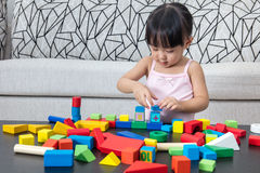 Asian Chinese little girl playing building blocks at home Royalty Free Stock Photos