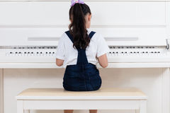 Asian Chinese little girl playing classical piano at home Royalty Free Stock Photography