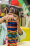Asian Chinese little girl playing colorful magnet plastic blocks. Kit at indoor playground Stock Photography