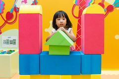 Asian Chinese Little Girl Playing Giant Blocks royalty free stock photos