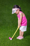 Asian Chinese little girl playing golf Stock Photo