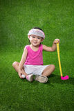 Asian Chinese little girl playing golf Royalty Free Stock Images