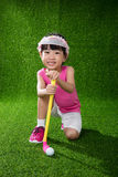 Asian Chinese little girl playing golf Royalty Free Stock Image