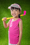 Asian Chinese little girl playing golf Royalty Free Stock Photos