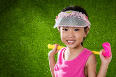 Asian Chinese little girl playing golf Stock Photos