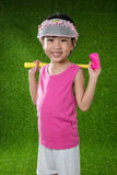 Asian Chinese little girl playing golf Stock Images