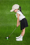 Asian Chinese little girl playing golf Royalty Free Stock Photography