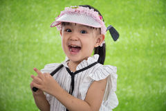 Asian Chinese little girl playing golf. On green grass Royalty Free Stock Photo