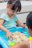 Asian Chinese little girl playing kinetic sand at home Stock Image