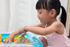 Asian Chinese little girl playing kinetic sand at home Stock Photography