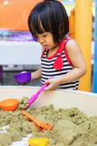 Asian Chinese Little Girl Playing Kinetic Sand Indoor Stock Images