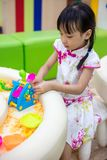 Asian Chinese Little Girl Playing Kinetic Sand stock photo