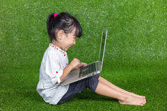 Asian Chinese little girl playing with laptop Stock Photography