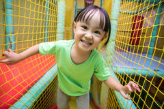 Asian Chinese little girl playing with net Royalty Free Stock Images